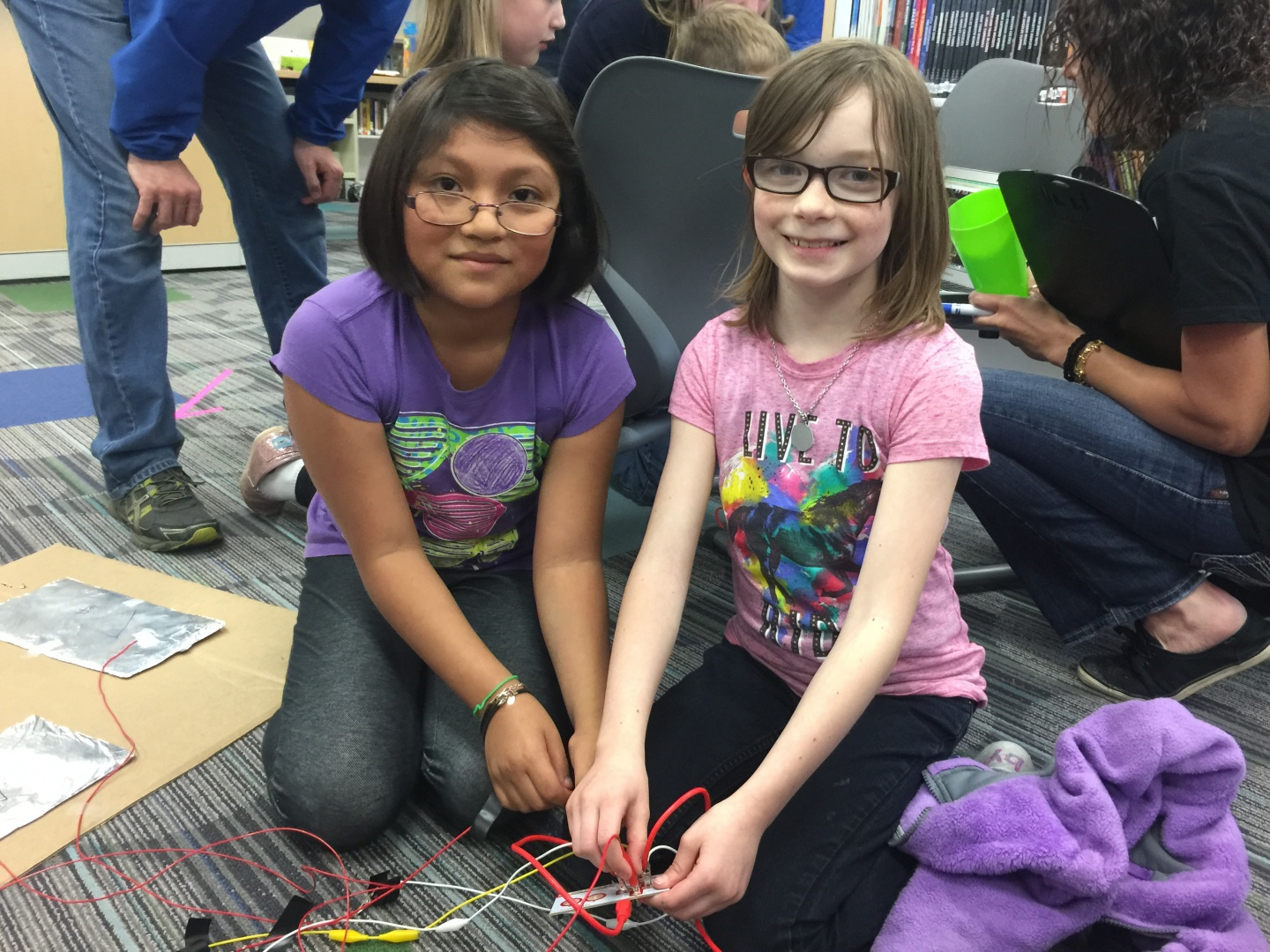 Edwards students learn to innovate using basic materials and sammy hernandez l and lizzy witcher adjust cables connecting circuits for their foot sciox Gallery